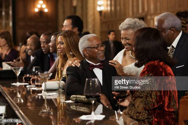 African American people drinking at bar