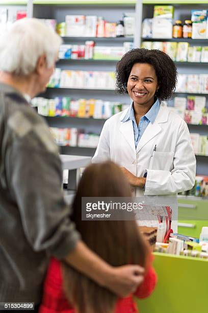 African American pharmacist in a pharmacy.