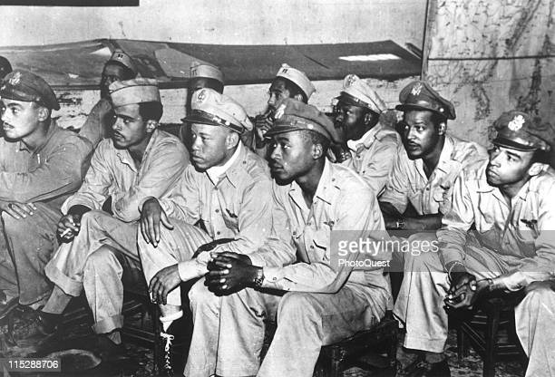 African American pilots of a P51 Mustang fighter group listen intently as they are briefed for a mission at a base in Italy September 1944