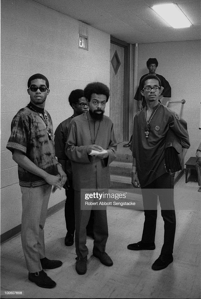 African American poet, writer, and civil rights activist Amiri Baraka (formerly LeRoi Jones) confers with a group of attendees at the Congress of African Peoples, Atlanta, GA, 1970.