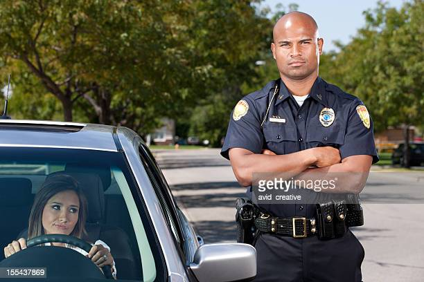 African American Police Officer Making Traffic Stop