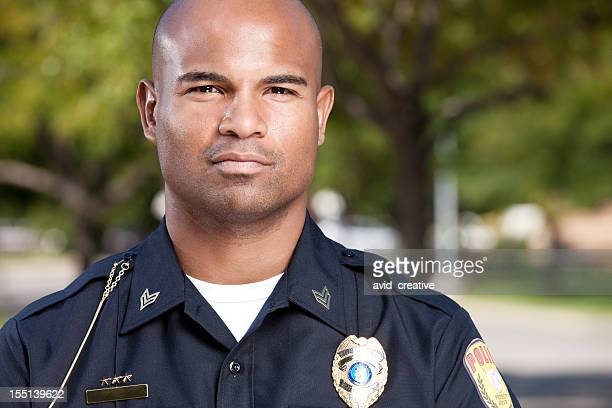 african american police officer portrait - police force stock pictures, royalty-free photos & images