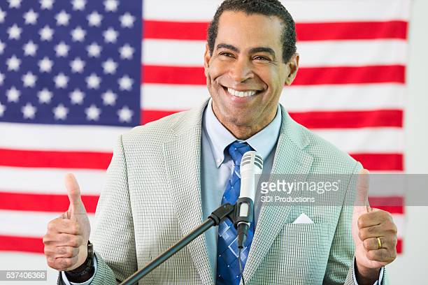 African American Politician gives thumbs up
