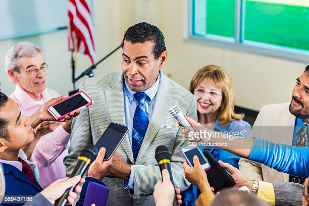african american politician speaks to media - american tv presenters stock pictures, royalty-free photos & images