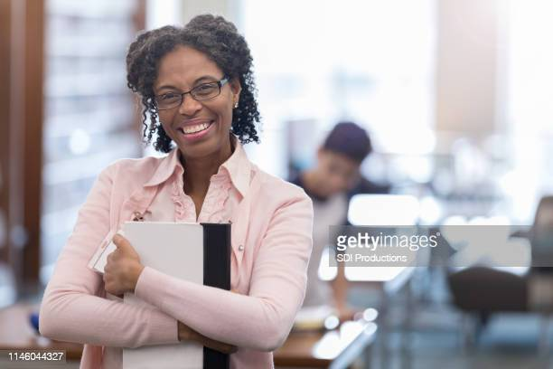 african american professor prepares for class - professor stock pictures, royalty-free photos & images