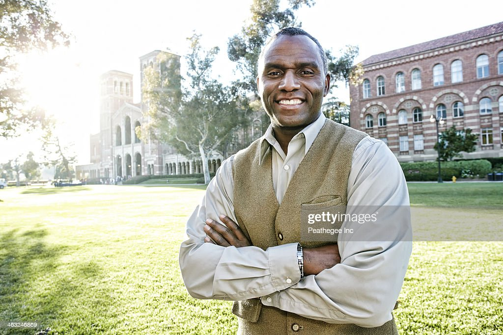 African American professor smiling on campus : Stock Photo