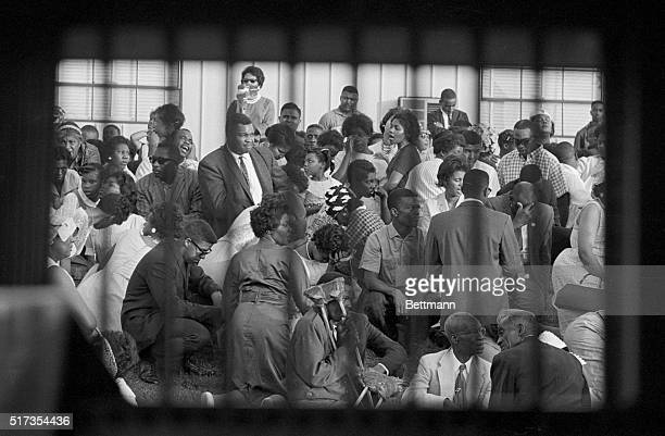 African American protesters seen through a paddy wagon window, sing and pray during a protest at the Birmingham Jail in Alabama.