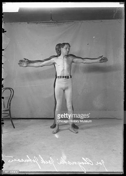 African American pugilist Jack Johnson standing behind pugilist Joe Choynski in front of a lightcolored backdrop Chicago Illinois 1909 From the...