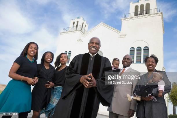 african american reverend and parishioners in front of church - congregación fotografías e imágenes de stock