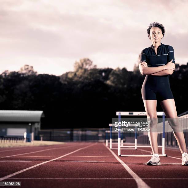 African American runner standing on track