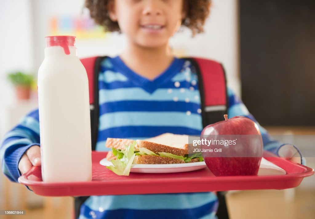 African American school girl holding lunch on a tray : Stock Photo