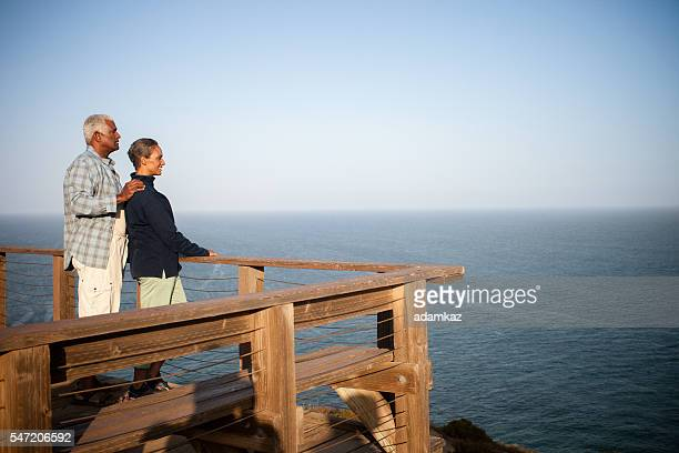 African American Senior Couple Looking Out Over the Ocean