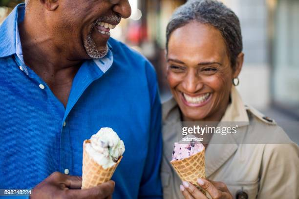 african american senior couple on the town with ice cream - valentine's day holiday stock pictures, royalty-free photos & images