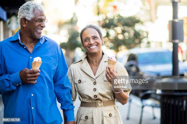 african american senior couple on the town with ice cream - downtown comedy duo stock pictures, royalty-free photos & images