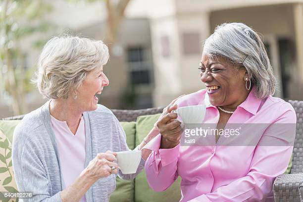african american senior woman, friend talking over tea - gossip stock pictures, royalty-free photos & images