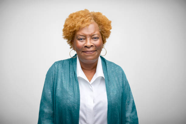 African American Senior Woman Smiling Against White Background