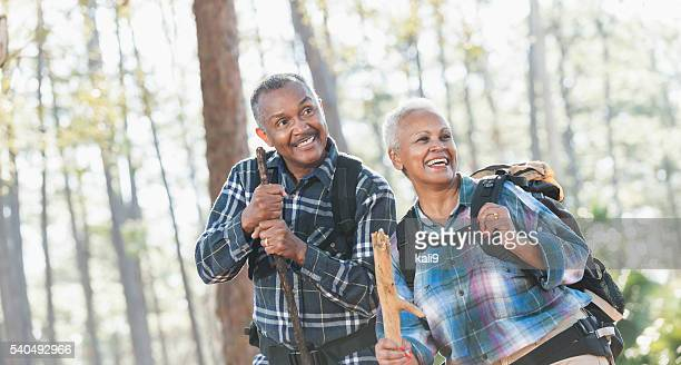 African American seniors hiking through woods