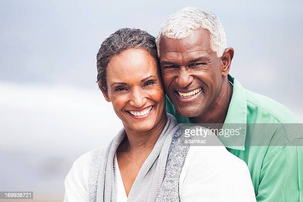 African American Seniors Smiling Together on Beach