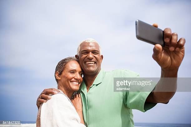 African American Seniors Taking Selfie Together on Beach