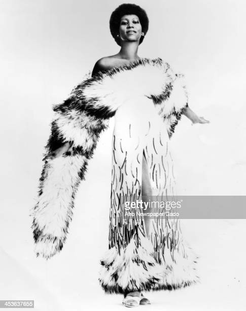 African American singer Aretha Franklin poses in a fur coat 1980