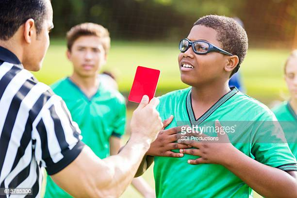 african american soccer player objects to referee's call - foul sports stock pictures, royalty-free photos & images