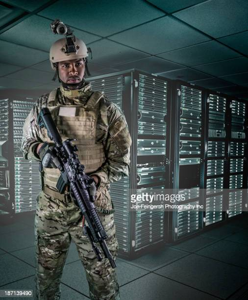 African American soldier in server room