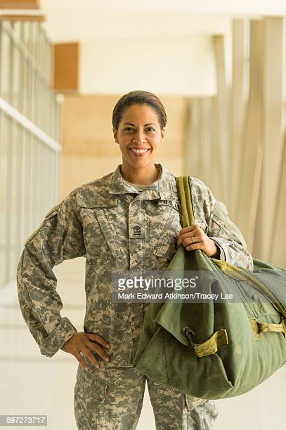 African American soldier smiling in airport