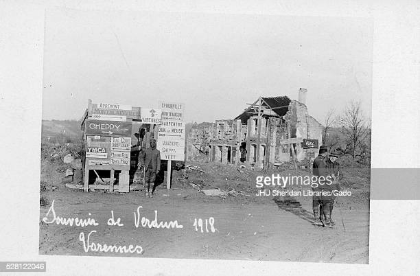 African American soldier standing in front of a board of signs in Cheppy France after the Battle of Verdun that took place during World War I two...