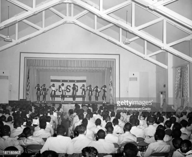 African American soldiers attend a USO show, Mississippi, 1942.