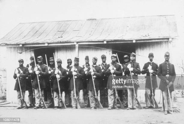 African American soldiers of the 107th US Coloured Infantry pose with rifles at Fort Corcoran during the American Civil War Virginia USA circa 1863...