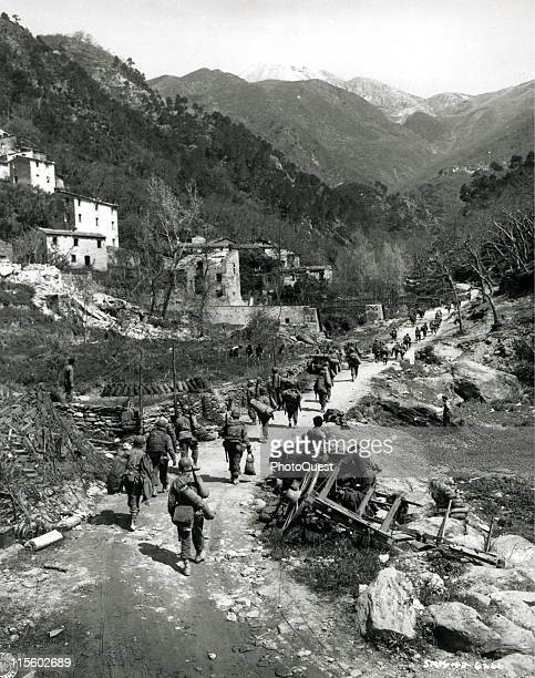 African American soldiers of the 92nd Infantry Division pursue the retreating Germans through the Po Valley, Italy, May 1945. German forces in Italy...