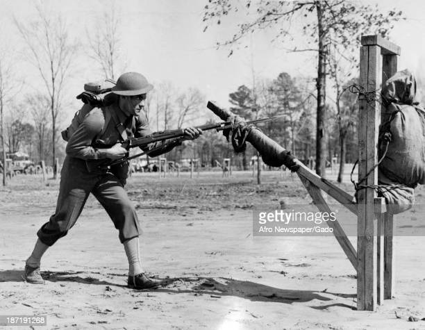 African American soldiers of the First Separate Aviation Squadron perform bayonet drills, Langley Field, Virgina, 1942.