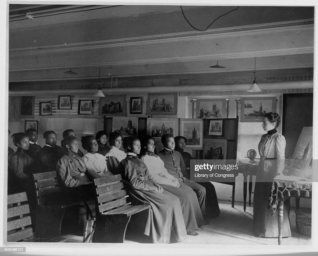 African American student in the classroom at the Hampton Institute in Hampton, Varginia, 1899.