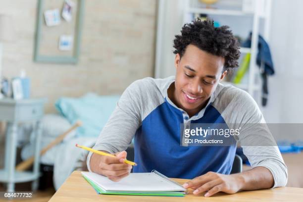 African American student works on homework
