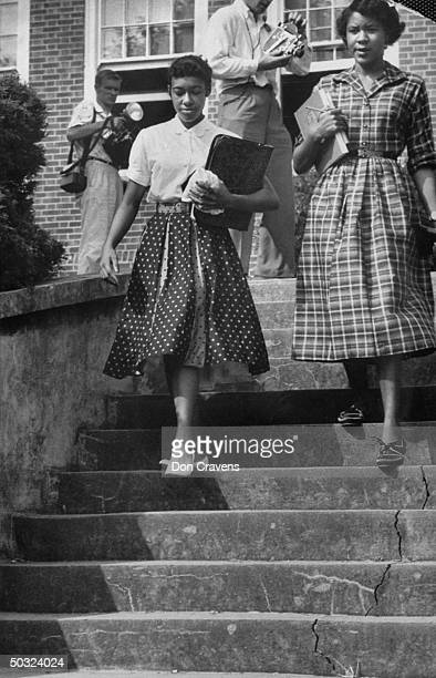 African American students JoAnn Allen Minnie Ann Dickey walk down the steps outside the recently desegregated Clinton High School Clinton Tennessee...
