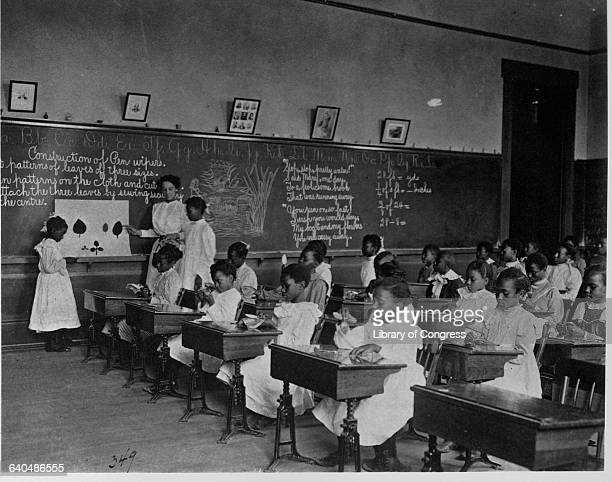 African American students make paper leaves in arts and crafts class 7th division public schools Washington DC