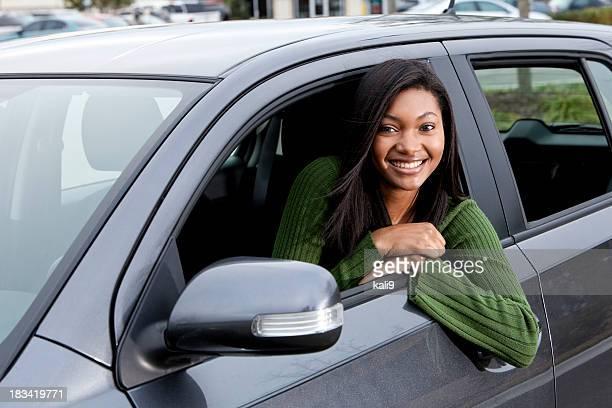 African American teenage girl driving car