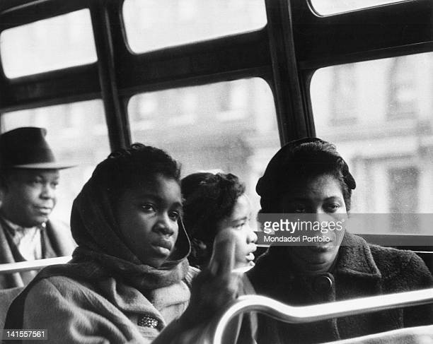 African American travellers sitting on a city bus in Harlem New York February 1956
