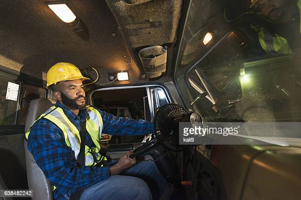 African American truck driver wearing hardhat