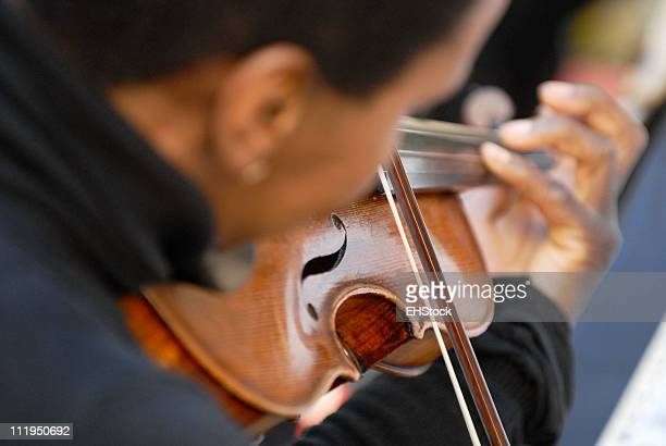 african american violinist over shoulder - musical quartet stock photos and pictures