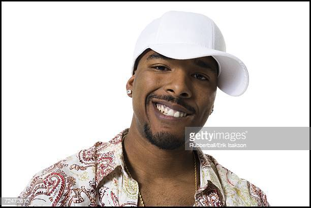African American with ball cap smiling