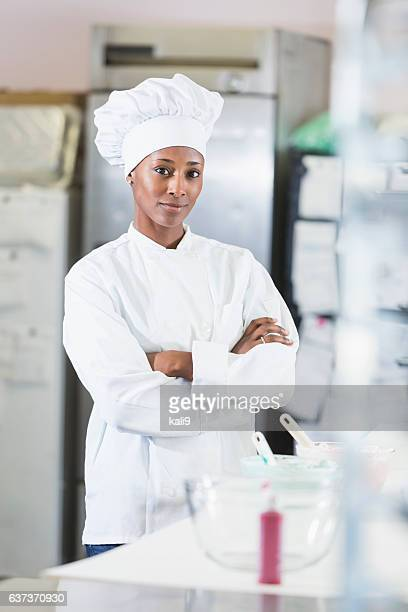 African American woman, a chef in commercial kitchen