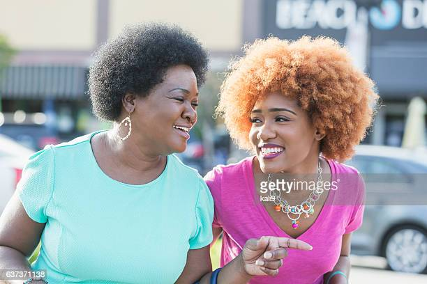 African American woman and adult daughter