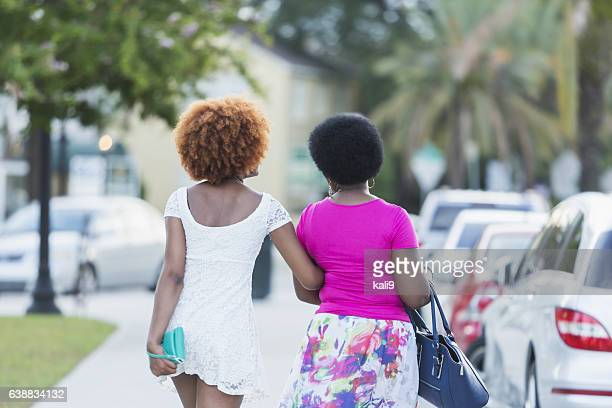 African American woman and adult daughter walking