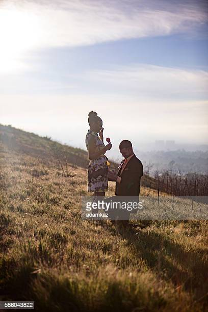 African American Woman and Caucasian Man get Engaged