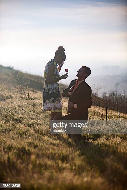 african american woman and caucasian man get engaged - black women engagement rings stock pictures, royalty-free photos & images