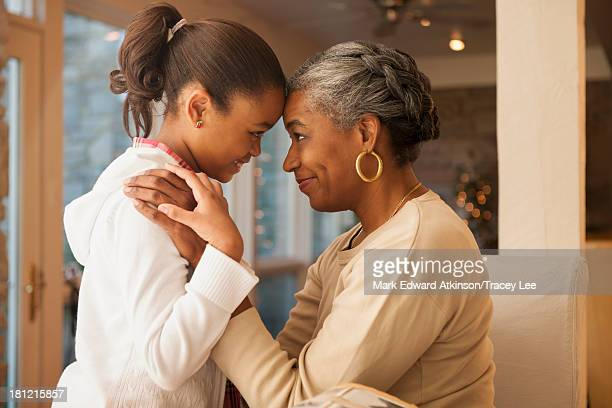 African American woman and granddaughter smiling