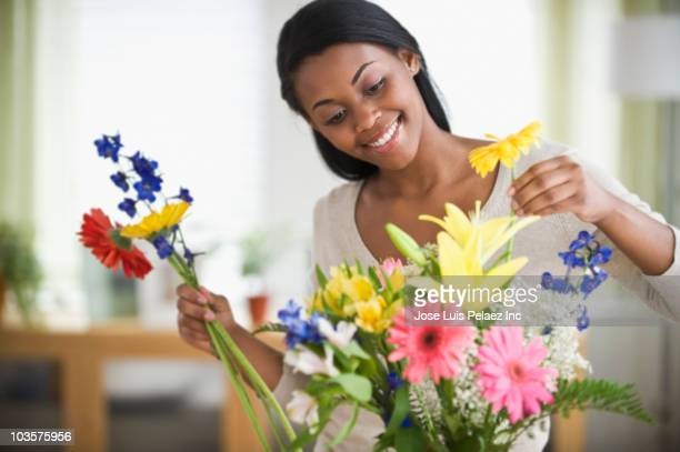 african american woman arranging flowers - positioning stock pictures, royalty-free photos & images