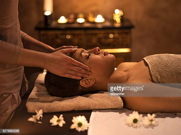 African American woman at the spa during facial massage.