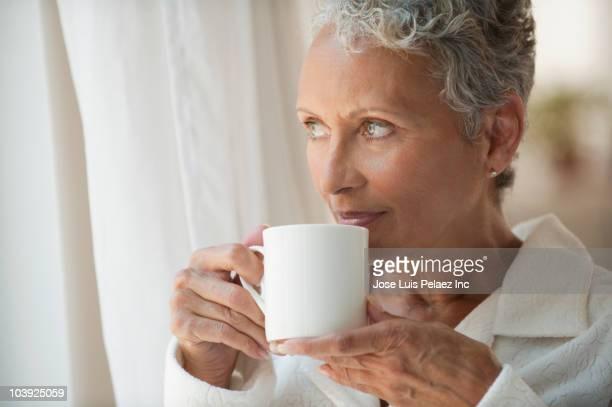 African American woman drinking coffee